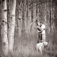 couple kissing in aspen trees.