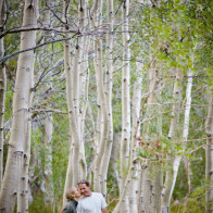 couple walking in aspen trees.