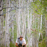 couple dancing in aspen trees.