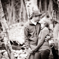 black and white photo of couple in aspen trees.