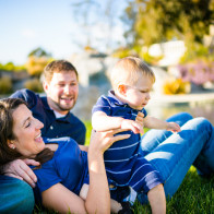 Relaxed family on lawn, Santa Barbara family photographer.